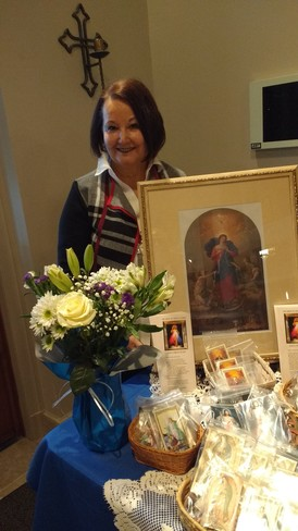 Picture of Linda at Rosary Table